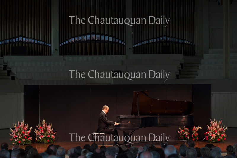 """Pianist Alexander Gavrylyuk performs Franz Schubert's """"Piano Sonata in A major, D. 664, op. 120"""" in a recital at 8:15 PM on July 20, 2016, in the Amphitheater. Although this was a solo recital, Gavrylyuk will also perform with the Chautauqua Symphony Orchestra at 8:15 PM on July 23, 2016, in the Amphitheater. Photo by Carolyn Brown."""