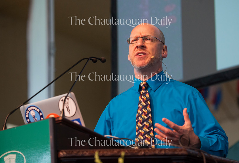"""Phil Plait, creator of Slate's """"Bad Astronomy"""" blog, delivers a lecture entitled """"Death from the Skies!"""" at 10:45 AM on July 18, 2016, in the Amphitheater.<br /> Plait discussed asteroid impacts and the accuracy of science fiction movies like """"Armageddon."""" Photo by Carolyn Brown."""