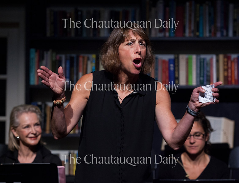 "Michele Keane, center, performs during a dress rehearsal of the Chautauqua Women's Club and Chautauqua Theater Company's joint production of Nora and Delia Ephron's ""Love, Loss, and What I Wore"" at 1 PM Monday, July 25, at Bratton Theater. Keane, along with Lee Heinz, Kathryn Chesley, and Lisa Wallace, played a member of a Greek chorus of four women. Photo by Carolyn Brown."