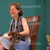 "Author Ann Patchett laughs at a joke in conversation with Roger Rosenblatt at the Amphitheater on June 30, 2016, as part of the Week One morning lecture series ""Roger Rosenblatt & Friends: On Creative Expression."" In their conversation, Patchett and Rosenblatt discussed varying topics, including caretaker for someone with a serious illness, why magic as a trade is often misogynistic,  Patchett's knack for financial management as a teenager, and the ""invisibilities"" that go into a novel. Photo by Carolyn Brown."
