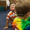 James Doherty, three, turns to greet his family members, who visited him at 11 AM on July 15, 2016, in the Green Room at Children's School. The children and teachers in the Green Room put on skits in which pairs of children acted out  the Little Miss Muffet nursery rhyme and did a Humpty Dumpty craft activity. Photo by Carolyn Brown.