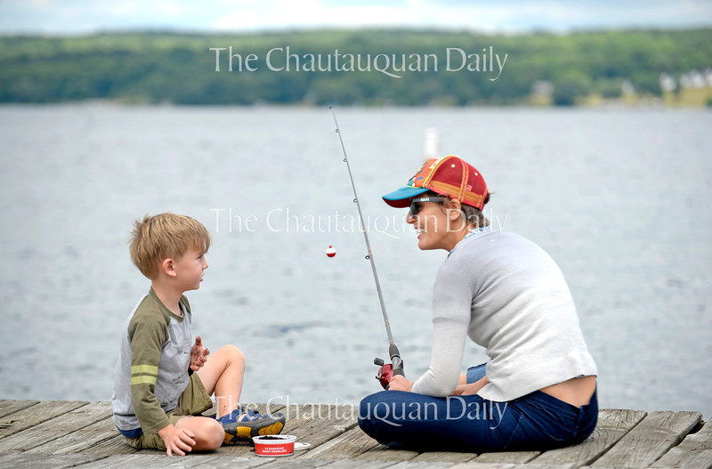 Kim Brown and her son Finley, 5, fish from a dock along the bank of Chautauqua Lake Wednesday, June 29, 2016.