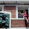 Henry Fox, 11, left, and his brother Tommy Fox, 9, read in front of the Post Office Building on Bestor Plaza Thursday, June 30.