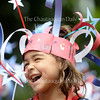 Hana Holland, 6, laughs as she walks in the annual Children's School Independance Day Parade Friday, July 1, 2016.