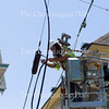 T Willy adjusts the utility line for clearance on the intersection of Miller Ave. and Roberts Ave. on June 20, 2016. Work is underway to prepare for the season's opening June 25.