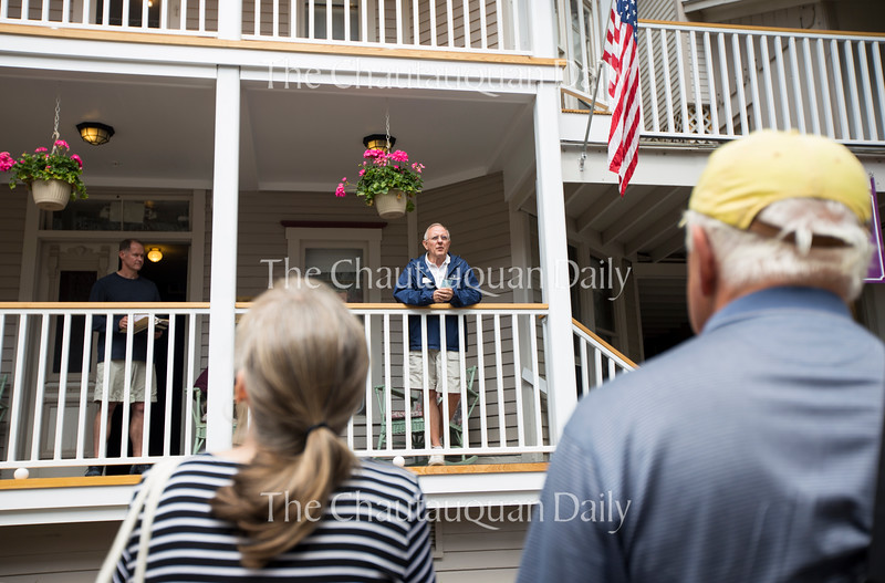 David Matthews welcomes Chautauquans to the rededication of the Ecumenical Community building following some extensive off-season renovations Tuesday, June 28, 2016. Their biggest concern regarding renovation was the safety of visitors. Photo by Eslah Attar