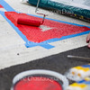 Dom Kimes, Artistic Director in the Visual Arts at Chautauqua Institution paints a mural on the crosswalk outside the Hultquist Center. Kimes hopes to finish the mural by Friday or Saturday in time for the seasons opening on June 25.