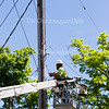 T Willy adjusts the utility line for clearance on the intersection of Miller Ave. and Roberts Ave. on June 20, 2016.Work is underway to prepare for the season's opening June 25.