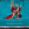 Ian Clute practices rescuing Alicia Gleason during lifeguard in service training Tuesday, June 21, 2016, at the Turner Community Center pool. The pool has been closed while undergoing renovations and is expected to reopen before the start of the season.