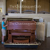 Jeremy Warsitz moves the organ in the Amphitheater into storage after it was tuned Tuesday, June 21, 2016. The organ still needs some more tuning before it will be ready for the season.