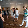 Chautauquans look at the 59th Chautauqua Annual Exhibition of Contemporary Art during the opening reception in Strohl Art Center on Sunday, June 26, 2016.