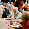 Guests enjoy a pasta dinner put on by the Fitchburg Holiday Decorating Committee on Wednesday evening at the Fitchburg Senior Center. Food donations were given by Pastaland, Midtown Beef and Cormier Catering. SENTINEL & ENTERPRISE / Ashley Green
