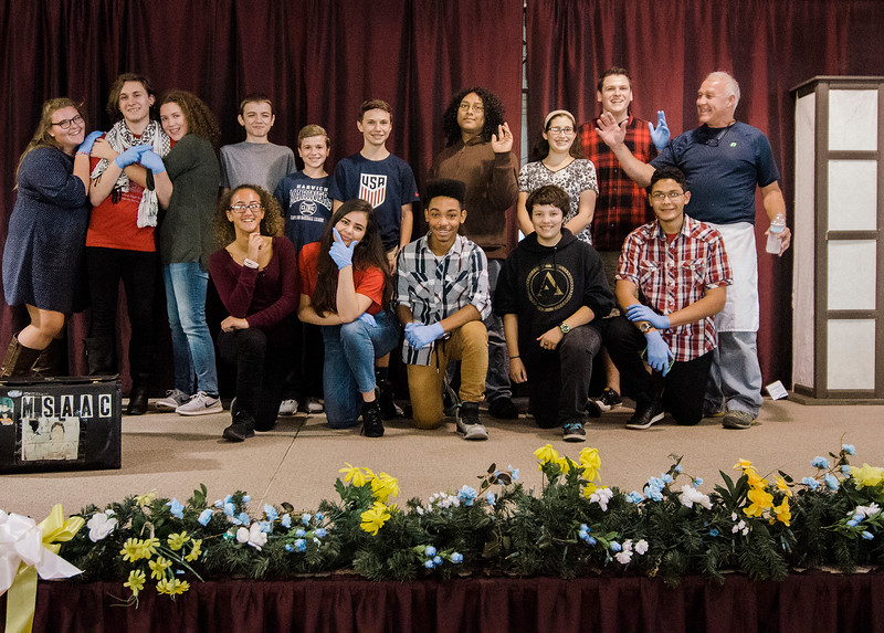 Student volunteers from FHS gather for a photo during a pasta dinner put on by the Fitchburg Holiday Decorating Committee on Wednesday evening at the Fitchburg Senior Center. Food donations were given by Pastaland, Midtown Beef and Cormier Catering. SENTINEL & ENTERPRISE / Ashley Green