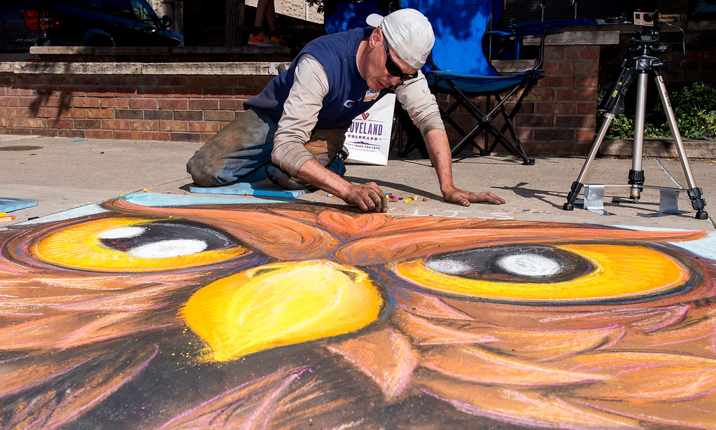 . Loveland artist Dion Weichers works on his Pastels On 5th sidewalk chalk art festival entry Saturday morning Sept. 10, 2106 in front of the Loveland Museum/Gallery on East Fifth Street. In its sixth year, Pastels on 5th is an free event designed to highlight the thriving Loveland arts community and benefits Alternatives to Violence, an organization committed to the intervention in, education about, and prevention of domestic violence, sexual assault, and other violent crimes. (Photo by Michael Brian/Loveland Reporter-Herald)