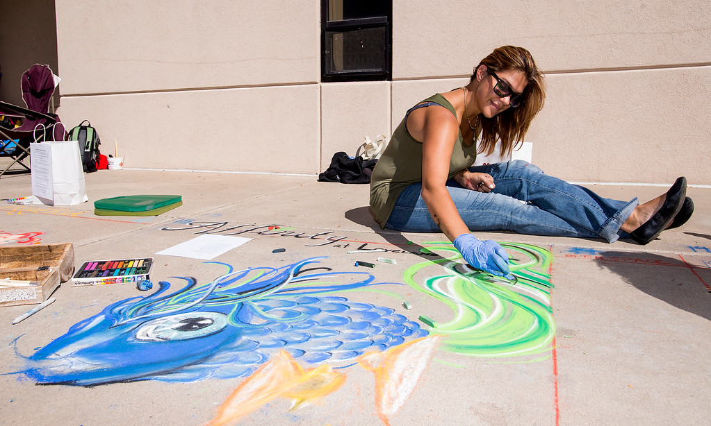 . Artist Tierra Coxsey came from Thornton to take part in Pastels on 5th Saturday morning Sept. 10, 2016 in downtown Loveland. (Photo by Michael Brian/Loveland Reporter-Herald)