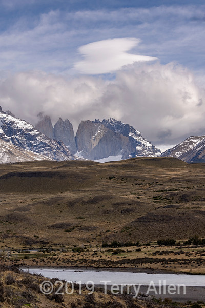 Lenticular clouds over Nido de Condores, Rio Paine in foreground, Tore Central and Torre Monzino from Amarga, Pategonia