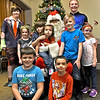 Never past up a photo opp with Santa, as the kids at the Patriot Dart League Sun Santa Annual Benefit at the Knickerbocker Club in Lowell did. SUN/ David H. Brow