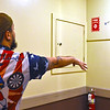 Throwing darts at the Patriot Dart League Sun Santa Annual Benefit fundraiser is Adam Volianites, at the Knickerbocker Club in Lowell. SUN/ David H. Brow