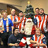 Patriot Dart League Sun Santa Annual Benefit Committee Members at the Knickerbocker Club with Santa, L-R, front kneeling James Volianites and Audrey Brazel, standing L-R, Dave Leonard Eileen Leonard, Jerry Jutras, Eric Bettencourt, Devin Curran, Adam Belleville, and Brenna Baker. SUN/ David H. Brow