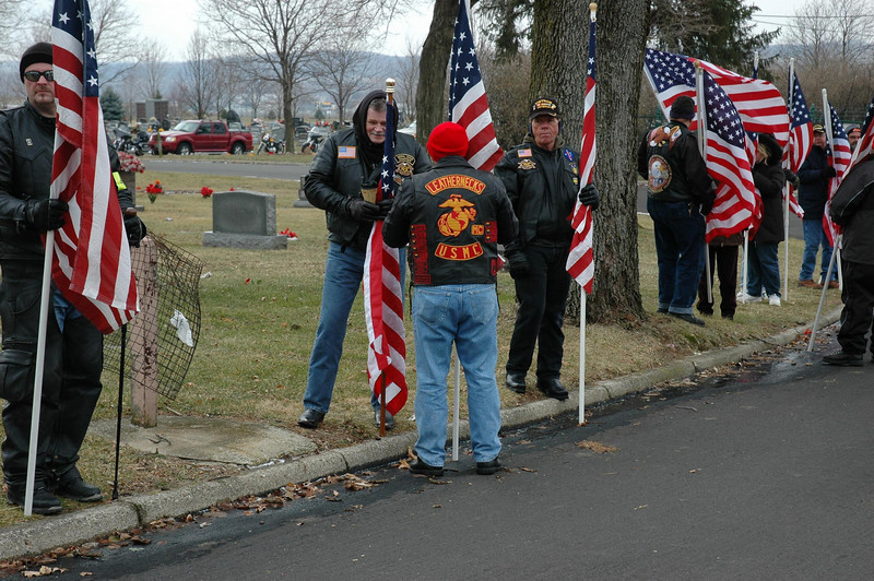 A forward unit of the PGR joined by the Marine Leathernecks prepares for maria's arrival at Calvary Cemetery.