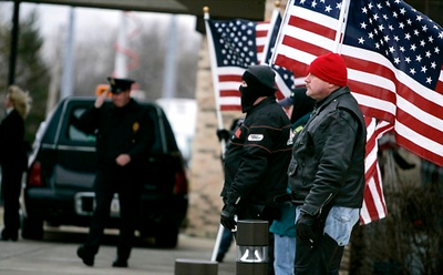 The Patriot Guard Riders stand guard as the family of Marine Lance Cpl. Maria Lauterbach's family held visitation. <br /> <br /> Photo by Jim Noelker/Dayton Daily News