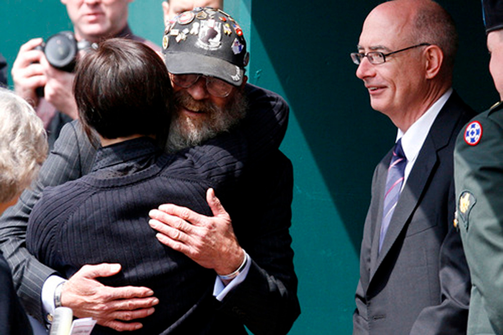 "Keith Maupin (CQ), the father of SSG Matt Maupin who was killed in Iraq, hugs Chase Sterling (CQ), Matt's former Sargeant in the Army, during a celebration service Sunday, April 27 at Great American Ball Park in Cincinnati, Ohio.  Sterling who is no longer inlisted, said, ""He was like my little brother,"" refering to Matt.   Staff photo by Nick Graham"