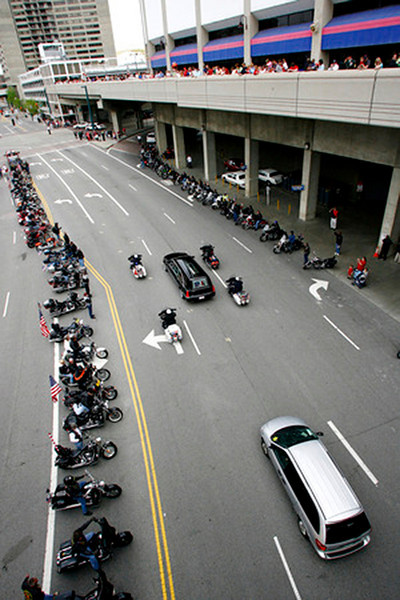 Thousands of motorcyclist line the road as the funeral procession passes for SSG Keith Matthew Maupin after a celebration service in his honor Sunday, April 27 at Great American Ball Park in Cincinnati, Ohio.  Staff photo by Nick Graham