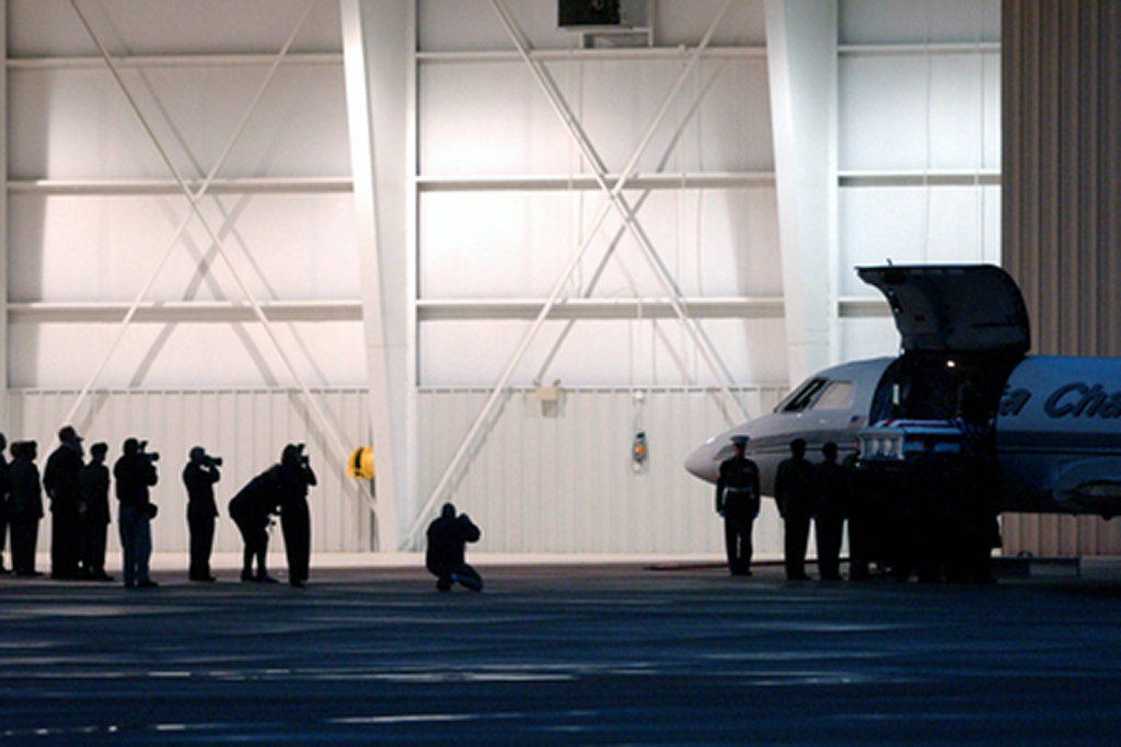 Members of the Maupin family watch as the casket of Staff Sgt. Matt Maupin is taken off the plane at Lunken Airport. Staff photo by Samantha Grier.