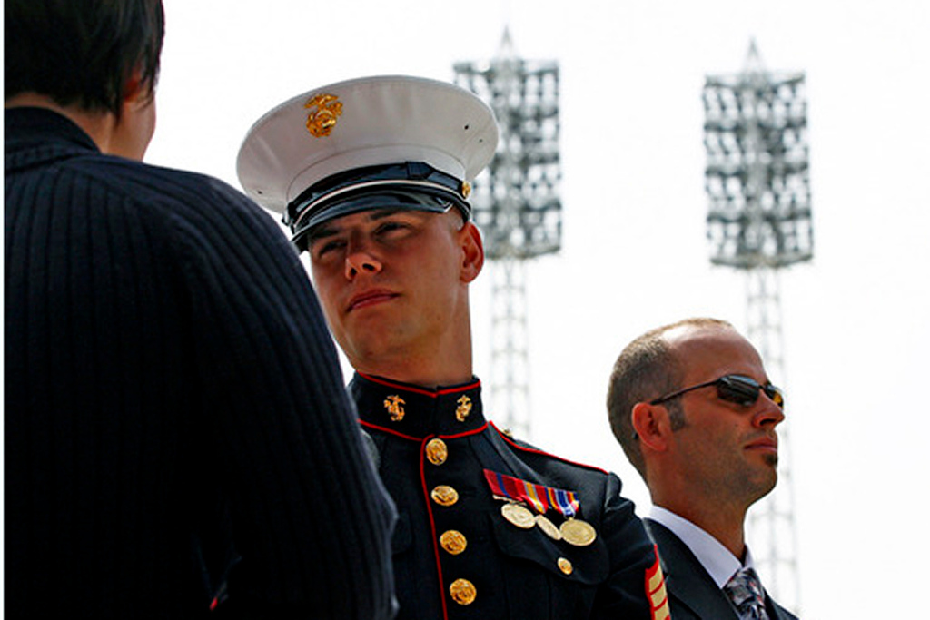 Marine Sgt Micah Maupin (CQ), Matt's younger brother, talks to Chase Sterling (CQ), Matt's former Sargeant in the Army, as older brother Stephen Spencer stands in the background during a celebration service Sunday, <br /> Staff photo by Nick Graham