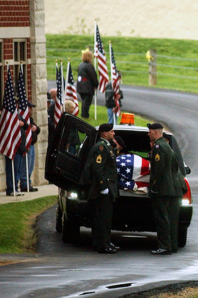 Pallbearers prepare to remove the casket of Staff Sgt. Matt Maupin from the hearse into the Union Township Civic Center. Staff photo by Samantha Grier.