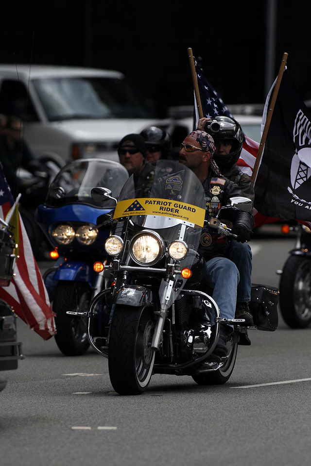 The Patriot Guard Ohio Captain and his Road Captains lead us.