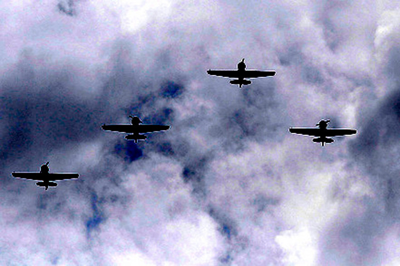 The Warbirds do a fly-over for SSG Keith Matthew Maupin, who was killed in Iraq, during a celebration service in his honor.  Staff photo by Nick Graham