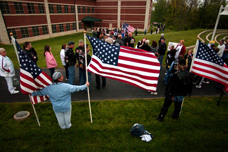 Teresa Russo Smith and her husband, Jim Smith of Mooresehill, Ind. hold flags at the visitation for Staff Sgt. Matt Maupin at the Union Township Civic Center. Staff photo by Samantha Grier.