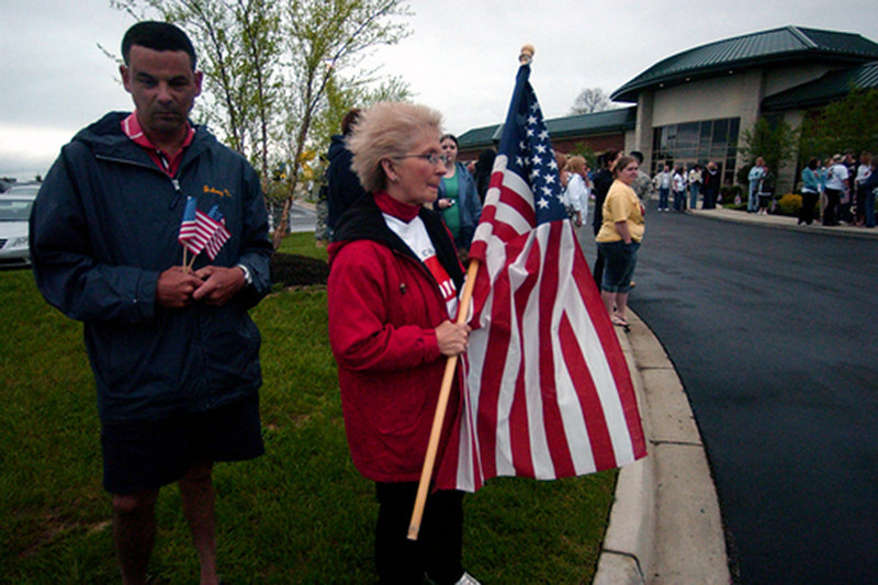 "Johnny Vilardo((cq)) and Nancy Stouder((cq)) of Milford stand outside the Union Township Civic Center for the visitation of Staff Sgt. Matt Maupin. ""This is so impressive; what an honor,"" Stouder said. ""[Matt's] dad never gave up."" Staff photo by Samantha Grier."