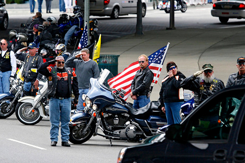Motorcycle riders lining the street stand attention as the funeral procession passes for SSG Keith Matthew Maupin after a celebration service in his honor.  Staff photo by Nick Graham