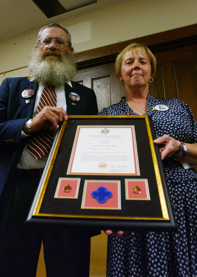 "Keith and Carolyn Maupin display the Certificate of Promotion they received Sept. 17 as part of the promotion ceremony for their son, Staff Sgt. Keith ""Matt"" Maupin, who has been missing since April 2004."