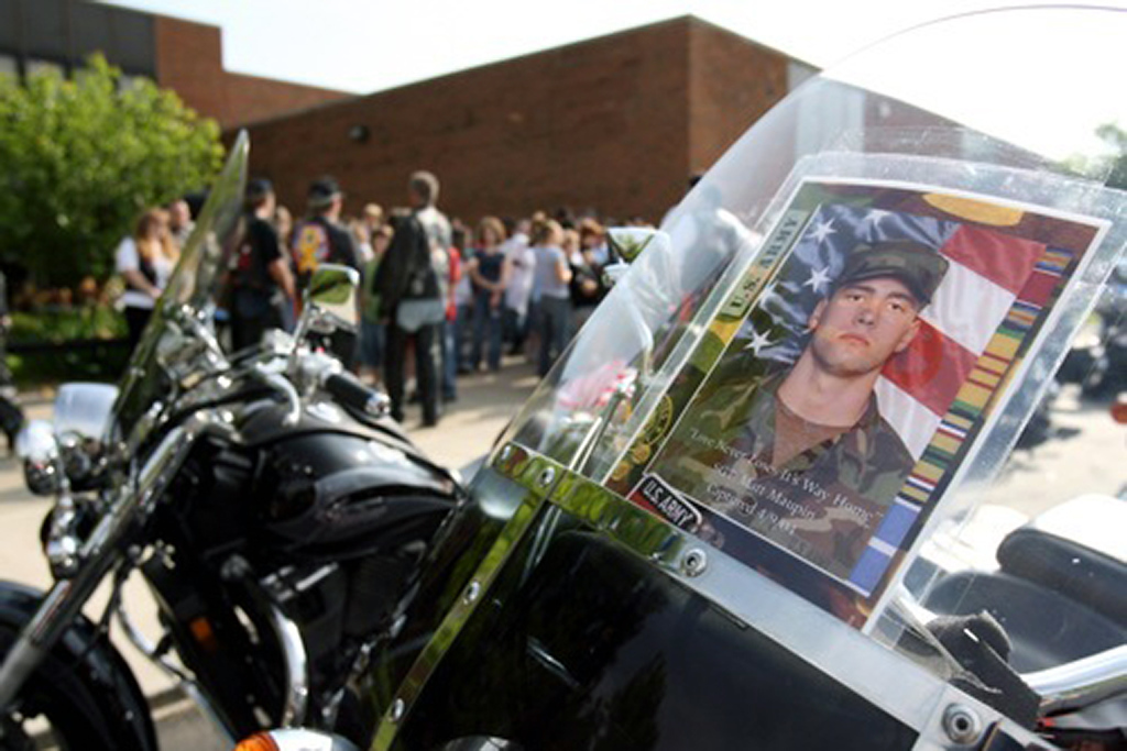 A photo of Matt Maupin is taped to the front of a Harley Davidson motorcycle.  <br /> <br /> Nick Daggy/Pulse-Journal