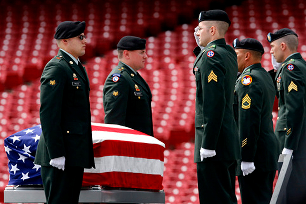 U.S. Army Honor Guard salutes the casket of SSG Keith Matthew Maupin during a celebration service in his honor. Staff photo by Nick Graham