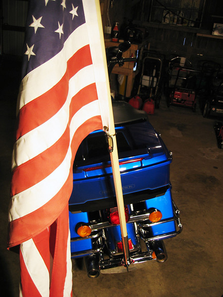 When in the holder on the bike I use a bungee cord to not only hold the flag down but it keeps the pole from coming out of the holder.<br /> <br /> I'm  not sure it's neccessary but I feel better knowing it's there!