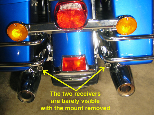 Installing the Rivco PF910 flag bar.<br /> <br /> Installing the two receivers for the flag holder is pretty simple and it requires removing the saddlebags. <br /> <br /> Once the bags are off you remove two bolts on each side replacing the top one with a longer one from the kit.<br /> <br /> When the bolts are out the rails spring away from the fender making It was difficult trying to align the holes plus stick in a couple of washers as spacers. <br /> <br /> It took a couple of tries but went back together without too much trouble. An extra set of hands would help.<br /> <br />  Don't forget to use blue Loctite on all the joints!