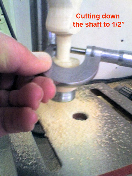 "Cutting the paint roller shaft down to 1/2"" in my drill press.<br /> <br />  I know the micrometer is a little over the top but it's all I had to measure with.  <br /> <br /> I try to keep my work plus or minus  three ten thousands ....."