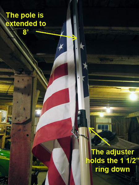 "Here is the pole extended to 8' and you can see how the bottom 1 1/2"" ring will not pass over the adjuster holding the bottom of the flag in place.<br /> <br /> Note: the intermediate or middle rings are 2"" and will slide over the adjuster."