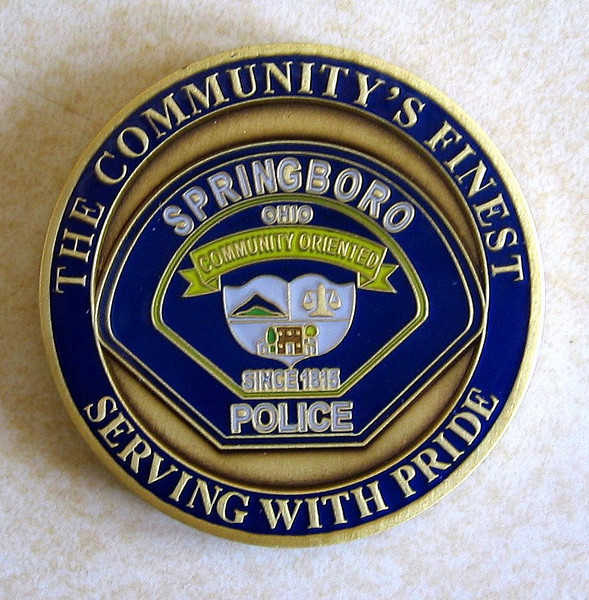 Springboro Police Chief Jeff Kruithoff presented each member of the PGR with a letter and Challenge coin.