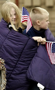 Miranda, 11, and Derek,8, keep warm as they wait for the funeral procession. <br /> <br /> Photo by Teesha McClam