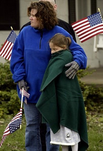 Dawn and her daughter Emily, 6, of Springboro wait for the funeral procession of Staff Sgt. Travis Griffin. <br /> <br /> Photo by Teesha McClam