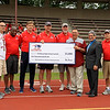 The New England Patriots Alumni organization held a free youth football clinic at Crocker Field in Fitchburg and also presented Fitchburg High School with a check for $1,000 on Thursday, June 8, 2017. From left are Fitchburg High football coach Tom DiGeronimo, Patriots alumni players Jon Williams, Ilia Jarostchuk, Steve Grogan, Peter Brock, Fitchburg Athletic Director Ray Cosenza, Mayor Steve DiNatalie and Rick Buffington. SENTINEL & ENTERPRISE / SCOTT LAPRADE