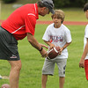 Photo Scott LaPrade - Steve Grogan explains a play to Dmitri Gonzalez age 11