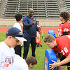 Photo Scott LaPrade - Vernon Crawford  Linebacker explains drill to kids