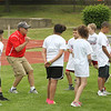 Photo Scott LaPrade - ex coach Rick Buffington shows some kids a drill