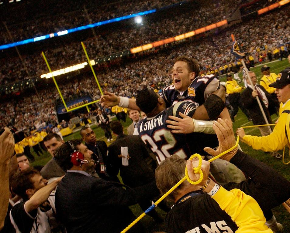 9a4f34c0374c0 New England Patriots quarterback Tom Brady and running back Antowain Smith  (32) celebrate